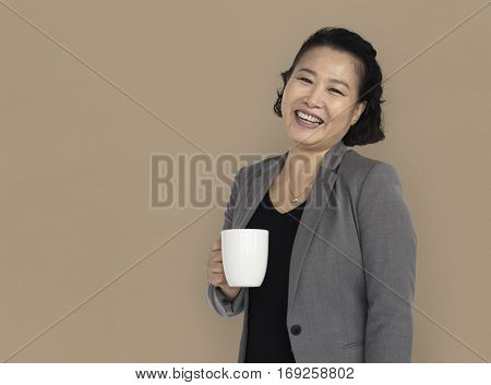 Asian Business Woman Holding Coffee Smiling