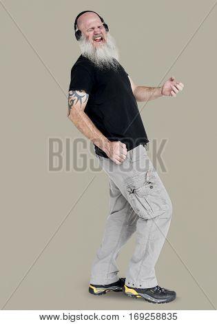 Bearded rocker guy playing air guitar portrait