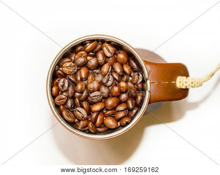 The brown coffee mill isolated.