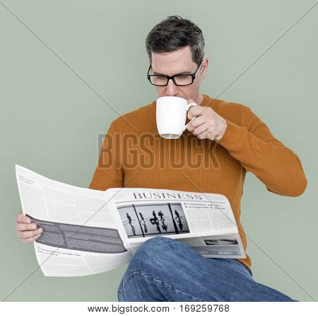 Man Reading Newspaper Information Coffee Drinking
