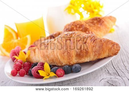 croissant with berry and orange juice