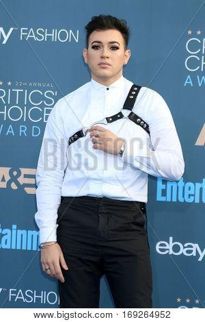 LOS ANGELES - DEC 11:  Manny Gutierrez at the 22nd Annual Critics' Choice Awards at Barker Hanger on December 11, 2016 in Santa Monica, CA
