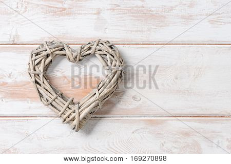 Wicker Rattan Heart On Wooden Panel With Copy Space