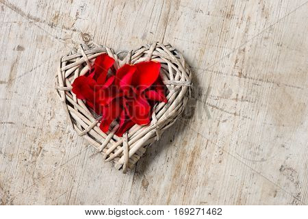 Wicker Heart Filled With Red Rose Petals Copy Space