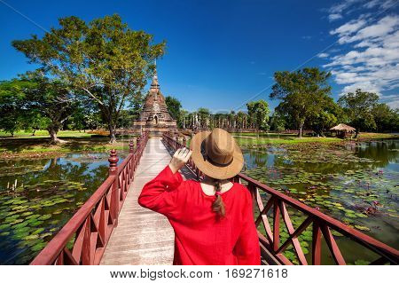 Tourist In Ancient Ruins Of Thailand
