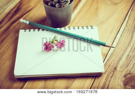 Pencil And Flower On Notebook Paper Education Concept Background.