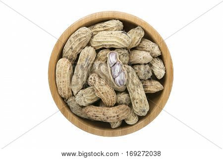 Top view groundnut in wooden bowl isolated on white background with clipping path
