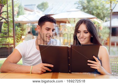 Romantic Couple on a Date Holding Restaurant Menu
