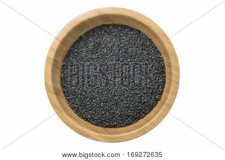 Top view of black sesame seeds in wooden bowl isolated on white background with clipping path