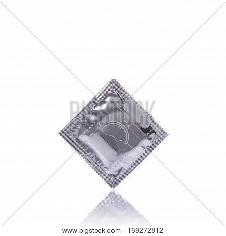 Condom In Silver Pack. Studio Shot Isolated On White