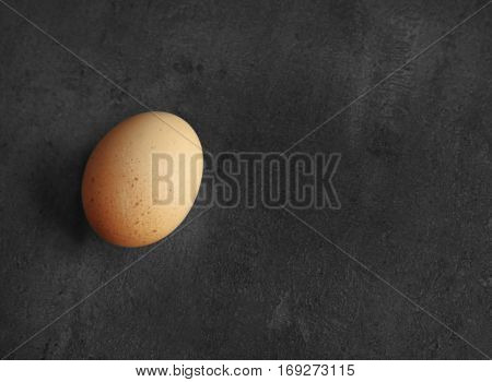 Raw egg on color background