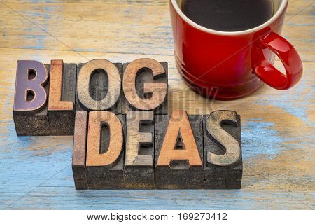 blog ideas - word abstract in vintage letterpress wood type blocks with a cup of coffee