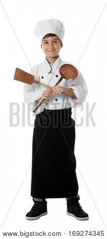 Cute boy in chef uniform on white background