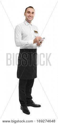 Young handsome waiter taking order on white background
