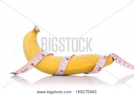 Yellow Banana With Measurement Tape. Men Penis Size Concept..studio Shot Isolated On White Backgroun