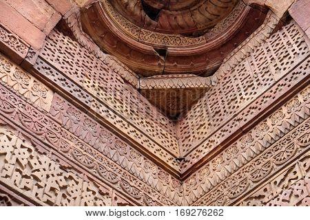 DELHI, INDIA - FEBRUARY 13: Stone carving on Qutab Minar, Delhi, India on February 13, 2016.