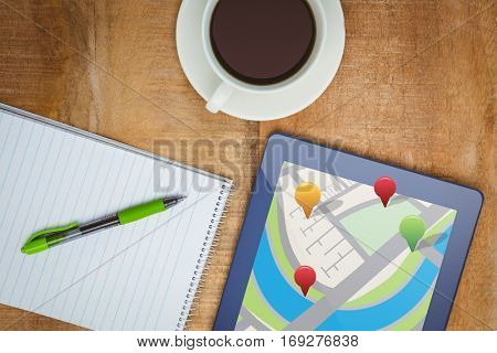 Map app against view of a blue tablet and a coffee