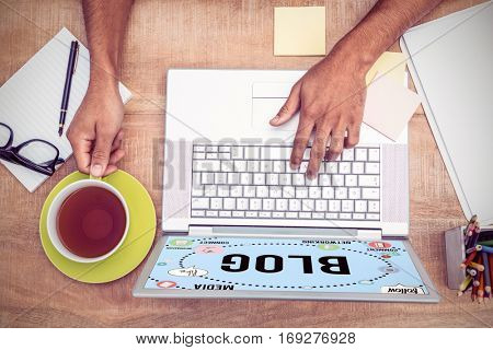 Interface of multimedia against overhead of businessman typing on laptop