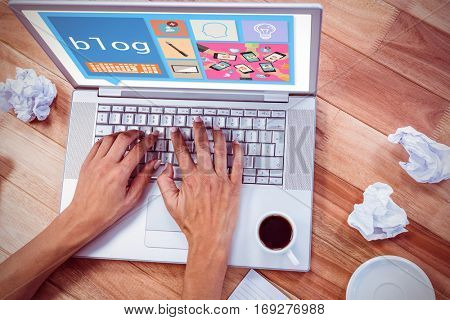 Bubble blog and pictures against part of hands typing on laptop