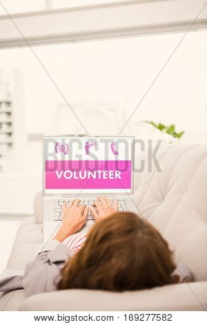 Grey volunteer against woman using laptop while relaxing on sofa