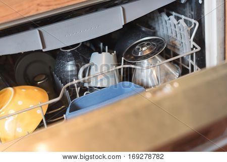 woman using a dishwasher, closeup images