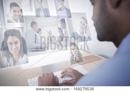 Business people having a meeting against businessman using computer at desk