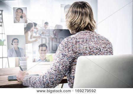 Business people having a meeting against man using graphic tablet