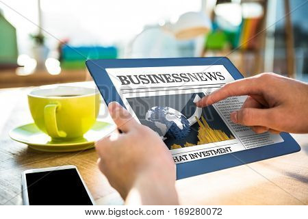 Business newspaper against cropped image of hipster businessman using tablet