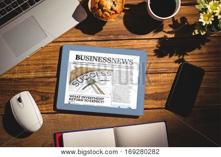 View of a desk against business newspaper
