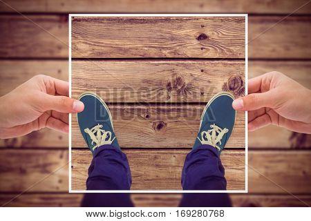 Composite image of hands holding black paper