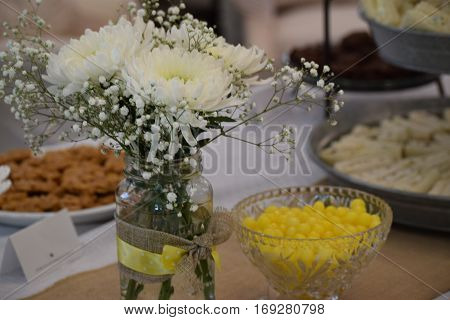 White flowers in a vase on a reception table