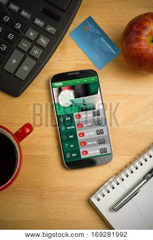 World credit card against smartphone on desk