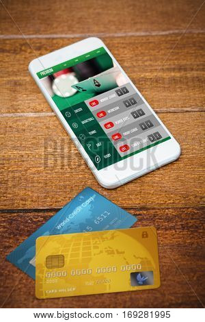 Credit Card against view of a white smartphone