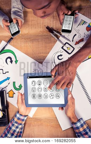 Telephone apps icons against overhead view of creative team working at desk