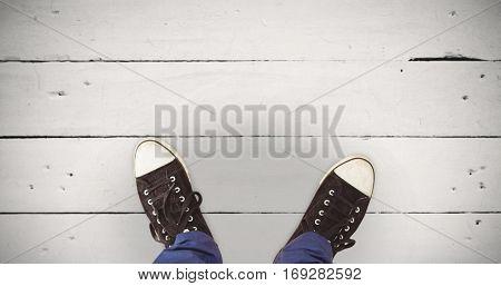 Man standing on hardwood floor against white wood