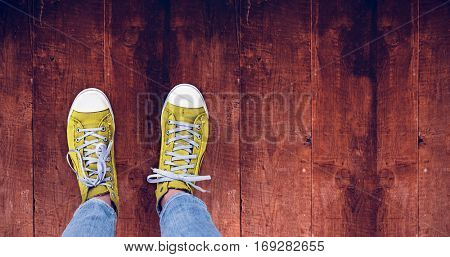 Casual shoes against weathered oak floor boards background