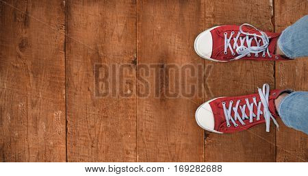 Casual shoes against wooden planks