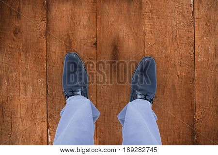 Low section of businessman against wooden planks