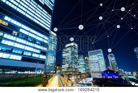 Business concept for information communication connection technology - panoramic modern city skyline bird eye aerial night view under dramatic glow and beautiful dark blue sky