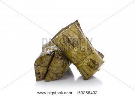 Thai Dessert, Khao Tom Mad, Steamed Sticky Rice With Banana. Studio Shot Isolated On White