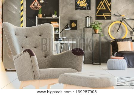 Grey Room With Stylish Upholstered Chair