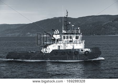 Tug Boat With White Superstructure