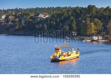 Yellow Ro-ro Cargo Ship Crossing The Bay