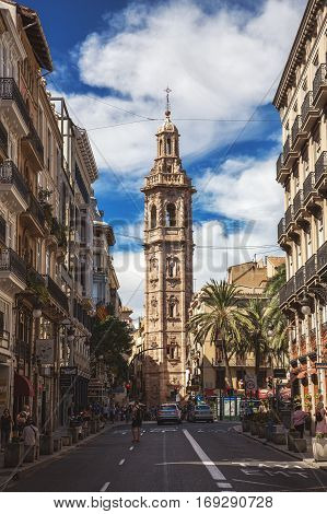 VALENCIA SPAIN - OCTOBER 1 2013: Street view with Santa Catalina tower. Santa Catalina is the only gothic church in the city and dates from the Middle Ages.