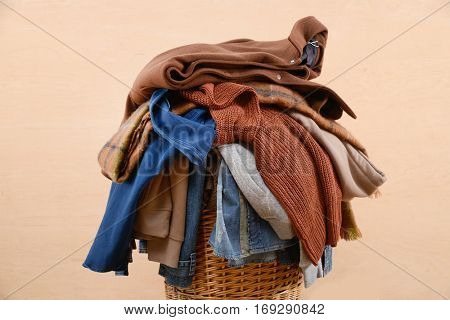 laundry in a basket, isolated on wooden background