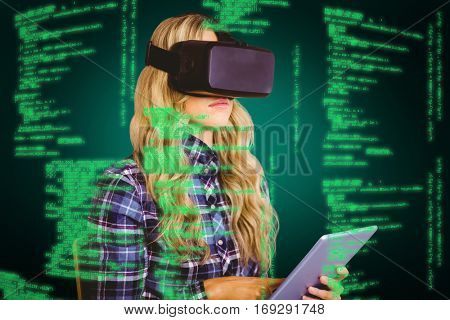Pretty casual worker using oculus rift against green background with vignette