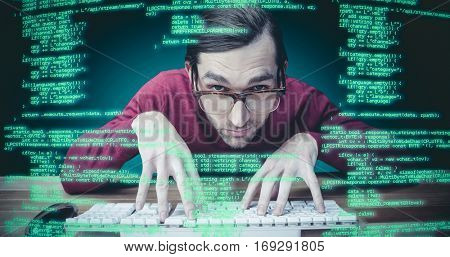 Man wearing eye glasses typing on computer keyboard against green background with vignette