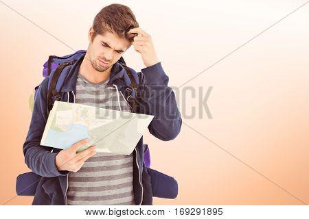 Man scratching head looking in map against orange vignette