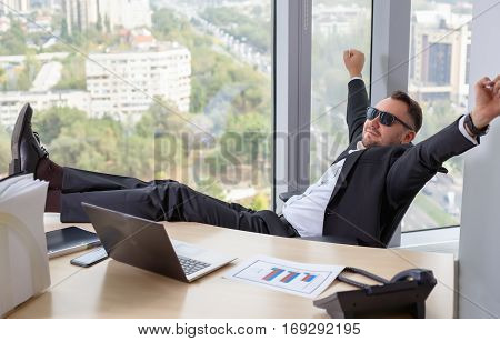 Businessman In Suit Working On Laptop