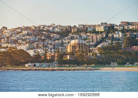 San Francisco cityline of houses with coast line. Panorama view of sunset in San Francisco